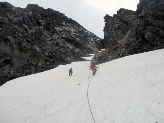 """Images of High snow depth on North Face of Ben Nevis in August - Climbers have encountered deep snow on Britain's highest mountain while assisting in a scientific project on the peak. It is not unusual for Ben Nevis to have coverings of snow all year. However, snow expert Iain Cameron has described the depth of the white stuff on the mountain's North Face as """"astonishing"""". Photographs of the snow, which could be more than 15m deep in places, were taken by Highland Mountain Company. The firm is assisting scientists who have reached the final week of a three-year programme to survey geology and also fauna and flora on the North Face of the Munro near Fort William. On Twitter, Mr Cameron tweeted the Highland Mountain Company's photographs with the message: """"Spot the climber. """"Utterly astonishing depth of snow yesterday on Ben Nevis. Possibly 15m+"""" Picture: Highland Mountain Company/Universal News And Sport (Scotland) 09/08/2016"""